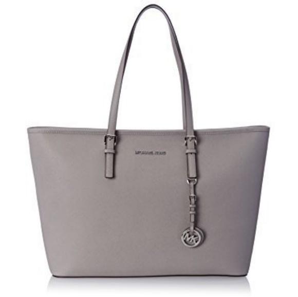 Michael Kors Handbags - NWT Michael Kors Jet Set Travel